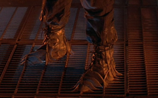 Terminator 2's T-1000 terminator's feet melting into grated metal floor
